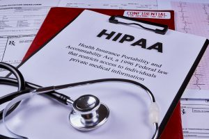 HIPAA notice on clipboard