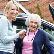 Elderly Woman Exiting Car